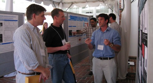 PhD students discuss posters with faculty at the Neuroplasticity Symposium